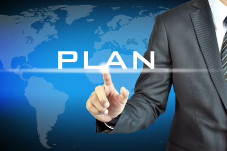 conspire: Businessman hand touching PLAN word on virtual screen - business abstract