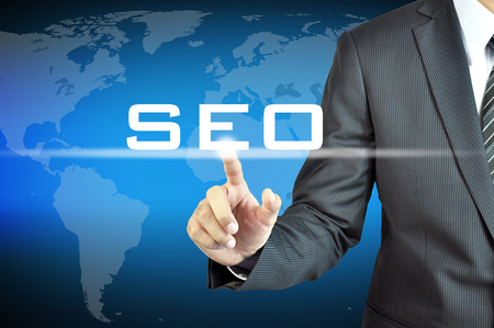 Businessman hand touching SEO  or Search Engine Optimization  sign on virtual screen - internet   online marketing concept photo