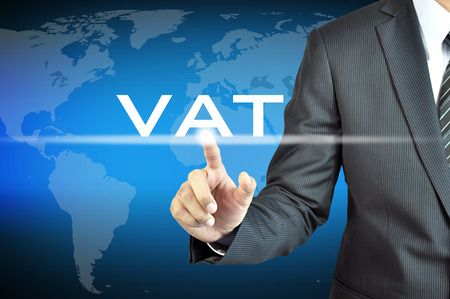 business value: Businessman hand touching VAT  or Value Added Tax  sign on virtual screen - commercial   taxation concept Stock Photo