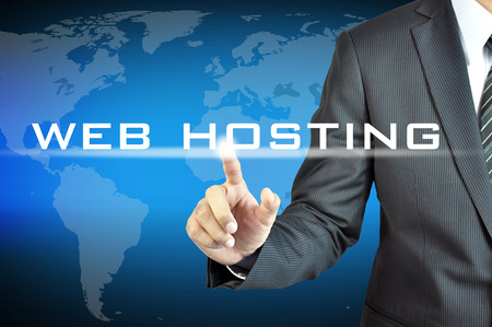 hosting: Businessman hand touching WEB HOSTING sign on virtual screen Stock Photo