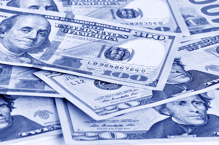 inducement: Money - United States dollars (USD) bills in retro blue color effect Stock Photo