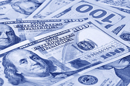 inducement: Money - 100 United States dollars (USD) bills - focusing on words THE UNITED STATES OF AMERICA Stock Photo
