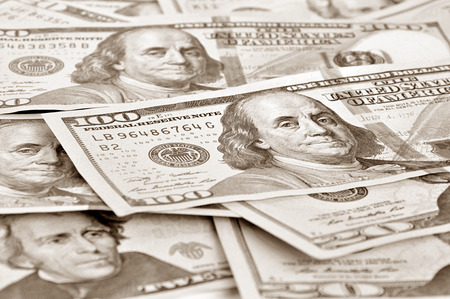inducement: Money - United States dollars (USD) bills in retro style sepia effect