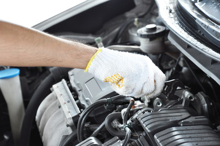 car engine: Hand with wrench repairing car engine