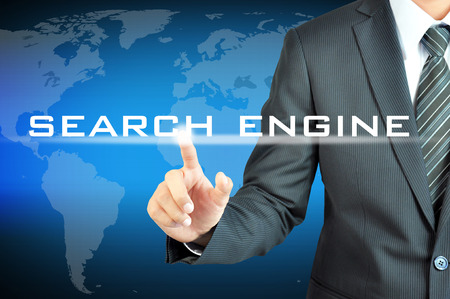 Businessman hand touching SEARCH ENGINE sign on virtual screen photo