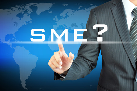 family business: Businessman hand touching SME(or Small and Medium Enterprises) sign on virtual screen - commercial & business concept