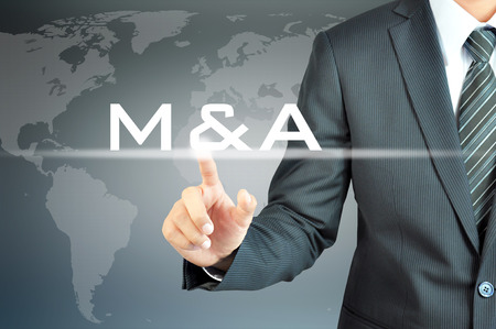 company ownership: Businessman hand touching M & A on virtual screen - merger & acquisition concept