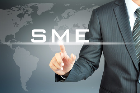 Businessman hand touching SME(or Small and Medium Enterprises) sign on virtual screen - commercial & business concept