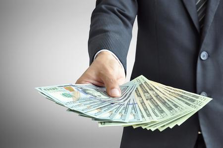 お金 - 米国ドル (USD) 札を持っている手 写真素材
