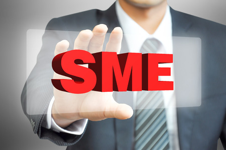 family business: Businessman hand holding virtual screen with SME sign