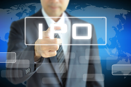 Businessman hand touching IPO (or Initial Public Offering ) sign on virtual screen - stock & investment concept