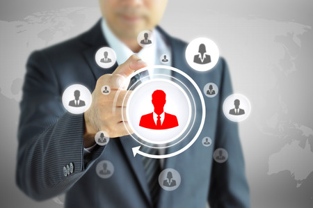 chosen: Hand pointing to businessman icon  - HR, recruitment and chosen concept
