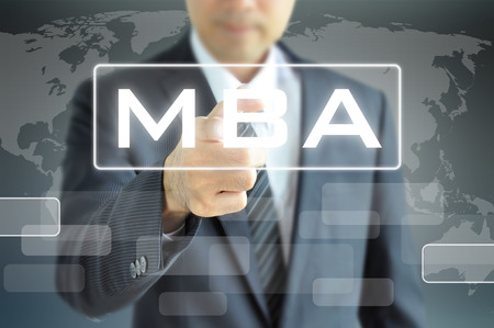 mba: Businessman hand pointing to MBA sign on virtual screen - education & business abstract