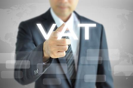 vat: Businessman hand pointing to VAT on virtual screen