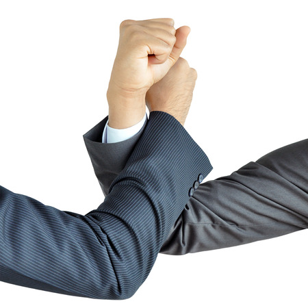 Businessman hands engage in arm wrestling