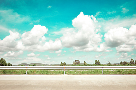 side road: Roadside view with green nature, clouds & sky - retro style lighting effect