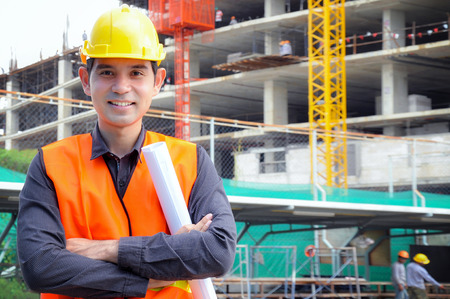 asian architect: Asian engineer or foreman in front of construction site