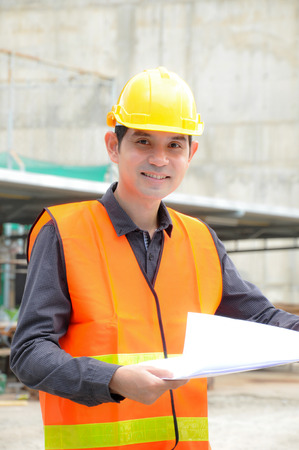 safety vest: Asian engineer or foreman wearing safety vest & hard hat Stock Photo