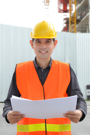 hard hat: Asian engineer or foreman wearing safety vest & hard hat Stock Photo