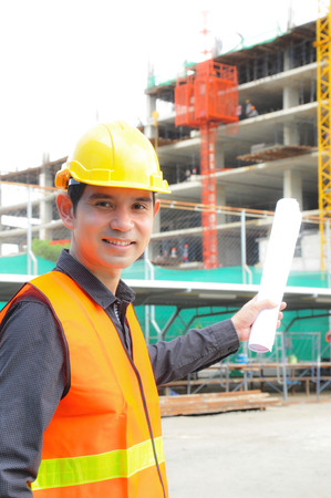foreman: Asian engineer or foreman in front of construction site