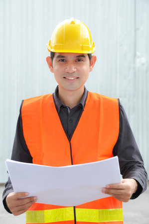 foreman: Asian engineer or foreman wearing safety vest & hard hat Stock Photo