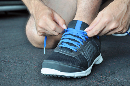 shoelace: Hands tying sports shoe Stock Photo