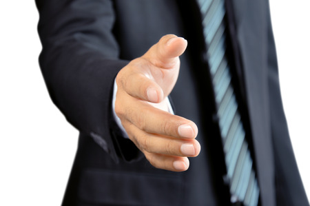 reaching hand: Businessman hand reaching out offering handshake
