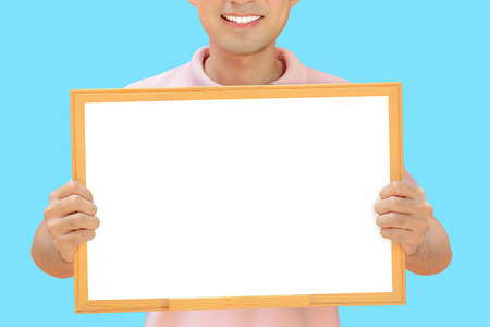 Smiling man holding empty whiteboard - can fill your texts & used as placard, notice & advertising boards etc. photo