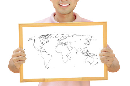 World map outline on whiteboard held by smiling man