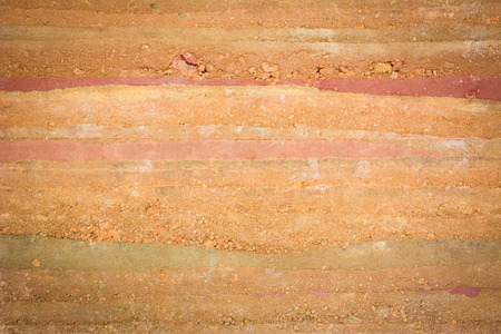 red soil: Texture of soil & stone layers