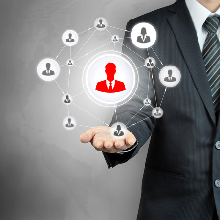 human resource management: Hand carrying businesspeople icon network - HR, HRM, MLM & teamwork concepts Stock Photo