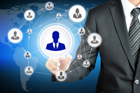 choose a path: Hand pointing to businessman icon in the middle that linked with each other as network - HR,HRM,MLM, teamwork & leadership concept Stock Photo