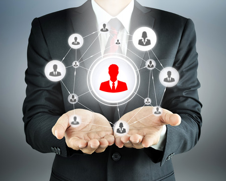 Hands carrying businesspeople icon network - HR, HRM, MLM & teamwork concepts Foto de archivo