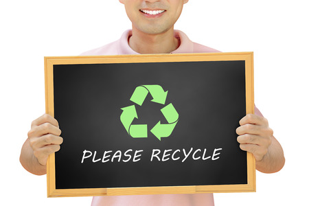 conservationist: Recycle sign with texts on blackboard held by smiling man - conservationist concept & recycle campaign