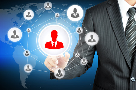 multi level: Hand pointing to businessman icon in the middle that linked with each other as network - HR,HRM,MLM, teamwork & leadership concept Stock Photo