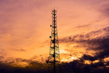 twilight: Telecom tower silhouette  in twilight sky background