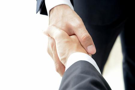 Handshake of businessmen - success, congratulation, greeting & business partner concepts Standard-Bild