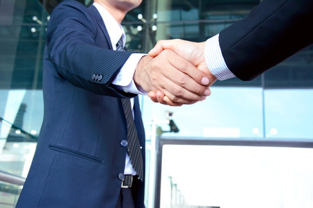 Handshake of businessmen - success, congratulation, greeting & business partner concepts Archivio Fotografico