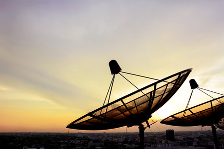 black dish: Satellite dishes on twilight sky background Stock Photo