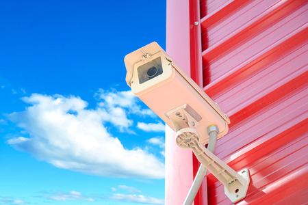 close circuit camera: CCTV or surveillance camera on red wall