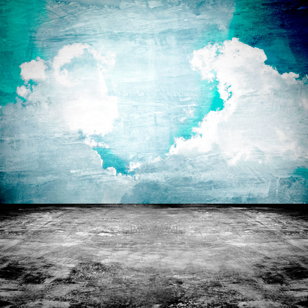 blue vintage background: Old grungy dark room with concrete floor & sky picture on the wall