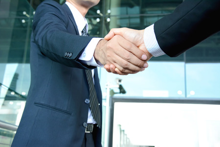 partners: Handshake of businessmen - success, dealing, greeting & business partner concepts Stock Photo
