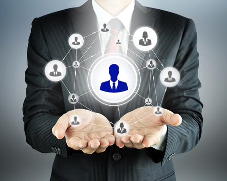 Hands carrying businessman icon network - HR,HRM,MLM, teamwork & leadership concept Stock Photo