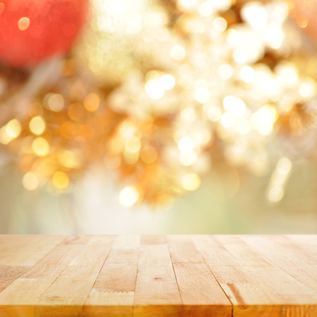 desktop background: Wood table top on blurry gold background - festive background concept