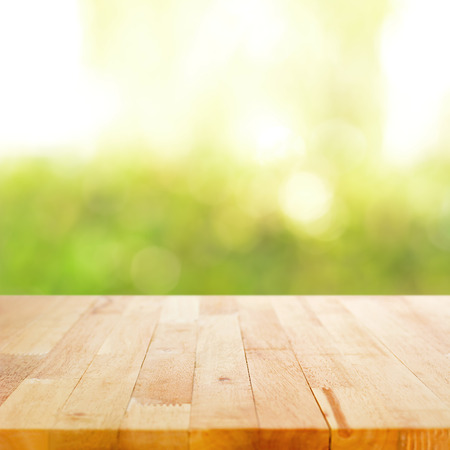 backdrops: Wood table top on bokeh green abstract background