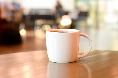 coffee shop: Coffee cup on the table in coffee shop blur background Stock Photo