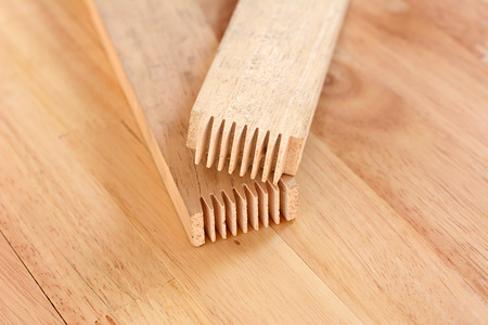 the finger: Finger joint at the end of wood sticks (or lumber)- one of woodworking joint Stock Photo