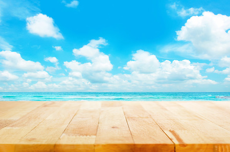 Wood table top on blue sea & sky background can put or montage your products for display - beach & summer concepts Imagens