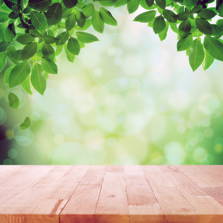 computer table: Wood table top on nature green bokeh abstract background Stock Photo