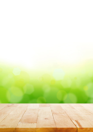 Wood table top on abstract white & green bokeh background Stock Photo